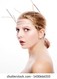 beauty model with headband of sticks and twine