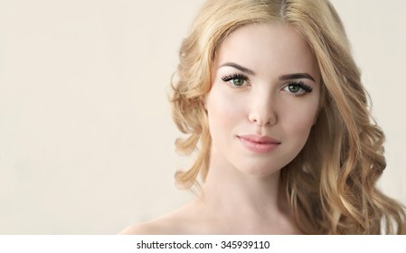 Beauty Model with  Perfect Fresh Skin and Long Eyelashes. Youth and Skin Care Concept. Spa and Wellness. Make up and Hair. Lashes. Close up, selected focus.