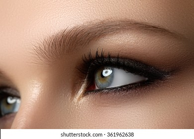 Beauty Model with Perfect Fresh Skin and Long Eyelashes. Youth and Skin Care Concept. Spa and Wellness. Make up and Hair. Lashes. Close up, selected focus