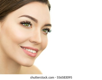 Beauty Model with  Perfect Fresh Skin and Long Eyelashes. Youth and Skin Care Concept. Spa and Wellness. Make up and Hair. Lashes. Isolated on white. Close up, selected focus.