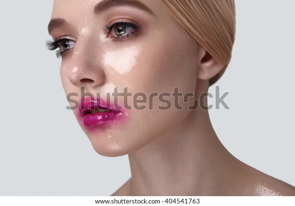 Beauty Model with wet Makeup on Skin