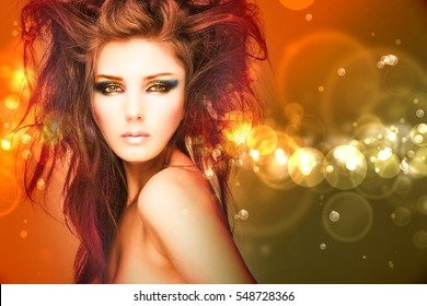 Beauty model woman with beautiful make up and curly hair style over holiday bright background with magic glow. Holiday celebration. Brunette Glamour lady with perfect make up and hairstyle