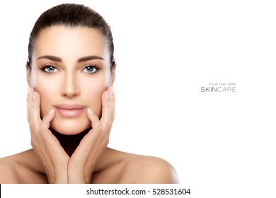 Beauty model woman with hands on cheeks looking at camera with a serene expression in a beauty and skincare concepts. Perfect skin with no makeup makeup. Portrait isolated on white with copy space