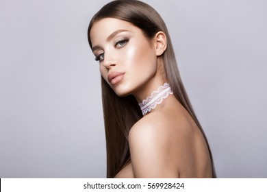 Beauty Model Woman with Long Brown Hair. Healthy Hair and Beautiful Professional Makeup. Gorgeous Glamour Lady Portrait. Haircare, Skincare concept.