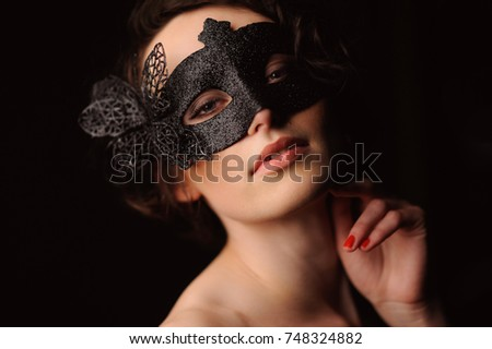 d23f3fc0c9818 Beauty model woman wearing venetian masquerade carnival mask at party  isolated on black background. Christmas
