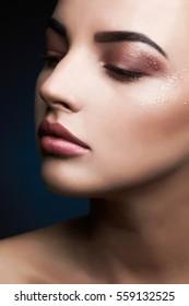 Beauty Model Woman.Beautiful Professional Makeup. female face.Sexy Lips. Beauty Makeup with glitter eye shadows