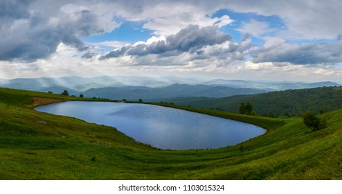 The beauty of mountain lake with sunbeams in distance. Osogovski mountains, Macedonia.