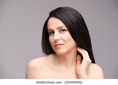 Beauty natural portrait with hand. Cosmetology skin care. Young female.