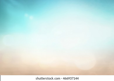 Beauty nature concept: Bokeh Sun light with abstract blurred beach autumn sunrise background