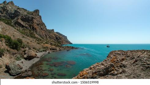 Beauty nature sea landscape Crimea ( volcano Karadag, Koktebel) seashore with mountainous terrain, horizontal photo