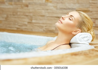 Beauty needs rest. Horizontal shot of a woman enjoying her time in the Jacuzzi with her eyes closed