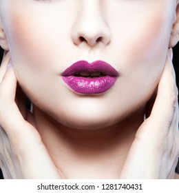 Beauty part of face, lips and neck of model girl. Dark lips make-up, perfect fresh clean skin. Woman portrait skincare facial treatment concept. Black background