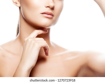 Beauty part of girl face. Clean skin, natural lips, nude make-up, hands near head. White background
