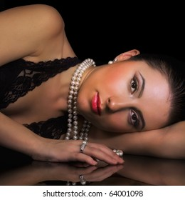 Beauty with pearl jewelry on black