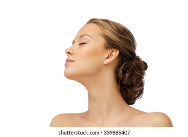 beauty, people and health concept - young woman face with closed eyes and shoulders side view