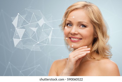 beauty, people and skincare concept - smiling woman with bare shoulders touching face over gray background with low poly projection and pointers