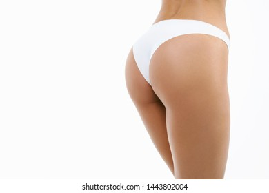 Beauty perfect slim body: fit sporty and healthy woman posing at white background in underwear. Sport, wellness, fitness, diet, weight loss and healthcare concept