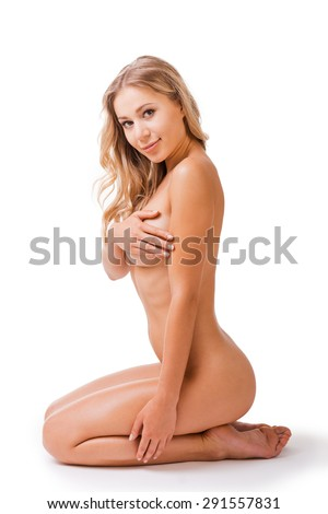 Beautiful Young Naked Woman Covering Breasts With Hand And Looking At Camera