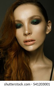 Beauty photo.  Girl with red hair and green make up
