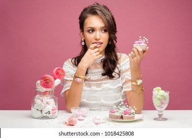 Beauty photoshoot with jewelry and cakes, sweets