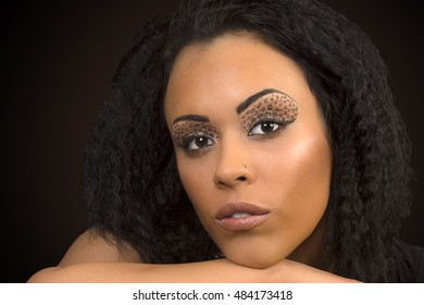 Beauty portrait about black woman with animal print eye shadow.