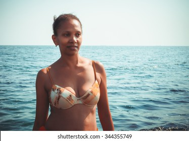 Beauty portrait of an African American black woman on a beach