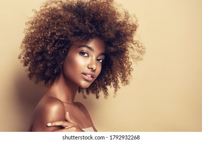 Beauty portrait of African American girl  with afro hair . Beautiful black woman . Cosmetics, makeup and fashion