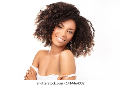 Beauty portrait of african american woman with clean healthy skin on white background. Skin care and beauty concept. Smiling beautiful afro girl.