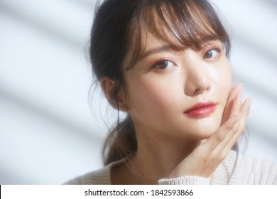 Beauty portrait of Asian woman with soft focus on light and shadow background