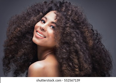 Beauty portrait of attractive african american woman with big afro and glamour makeup.