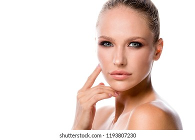 beauty portrait of attractive caucasian young woman blond isolated on white studio shot lips face perfect skin head and shoulders looking at camera eyes