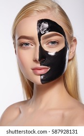Beauty portrait of attractive girls. Skin care face, black mask. White background.