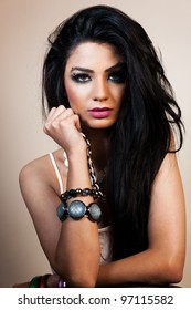 beauty portrait of an attractive Indian girl wearing jewelry