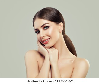 Beauty Portrait of Attractive Woman Spa Model with Healthy Skin and Long Brown Hair. Facial Treatment, Cosmetology, Beauty, Skin Care and Spa