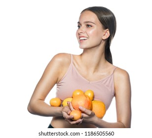 beauty portrait of attractive young caucasian happy smiling woman isolated on white studio shot eating orange  lemon fruit fresh healthy food raw diet