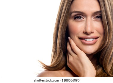 beauty portrait of attractive young caucasian smiling happy cheerful woman  isolated on white studio shot  lips toothy smile face long hair head and shoulders looking at camera teeth hand