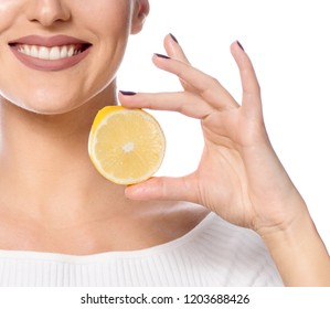 beauty portrait of attractive young caucasian happy smiling woman isolated on white studio shot with orange citrus fruit face makeup looking at camera