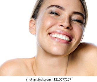 beauty portrait of attractive young caucasian smiling woman brunette isolated on white studio shot  lips toothy smile facer head and shoulders cheerful teeth neck hand looking at camera