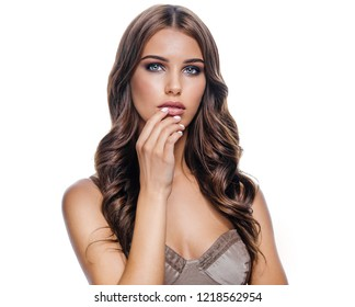 beauty portrait of attractive young caucasian woman brunette isolated on white studio shot lips face skin makeup long hair head and shoulders looking at camera hand nails