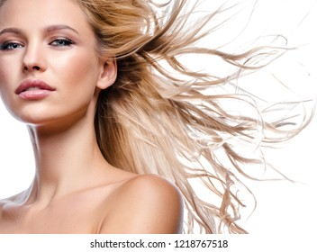 beauty portrait of attractive young caucasian woman blond isolated on white studio shot  lips face skin makeup long hair head and shoulders looking at camera