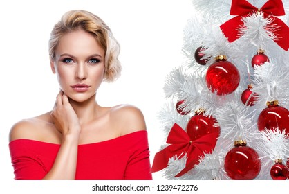 beauty portrait of attractive young caucasian woman blond isolated on white studio shot  lips  face skin makeup hair head and shoulders looking at camera christmas new year tree
