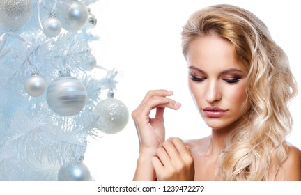 beauty portrait of attractive young caucasian  woman blond isolated on white studio shot  lips  face long hair head and shoulders christmas new year tree