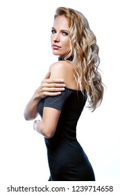 beauty portrait of attractive young caucasian woman blond isolated on white studio shot face makeup skin long hair looking at camera in black dress