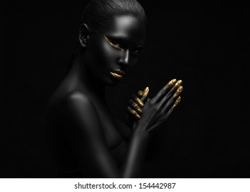 beauty portrait of a beautiful black woman with gold elements.