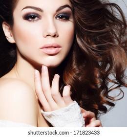 Beauty portrait of beautiful brunette girl in the studio