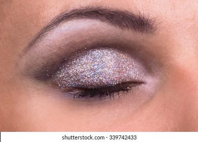 Beauty portrait of a beautiful girl. Bright festive makeup, glitter, glitters, bright lipstick.