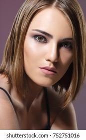 Beauty portrait of a beautiful girl with a stylish make-up.