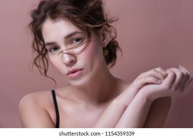 Beauty Portrait. Beautiful Spa Woman Touching her Face. Perfect Fresh Skin. Pure Beauty Model.