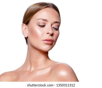 Beauty Portrait. Beautiful Spa Woman Touching her Face. Perfect Fresh Skin. Isolated on White Background. Pure Beauty Model. Youth and Skin Care Concept.