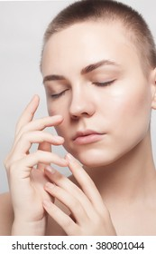 Beauty Portrait. Beautiful Spa Woman Touching her Face. Perfect Fresh Skin. Pure Beauty Model. Youth and Skin Care Concept